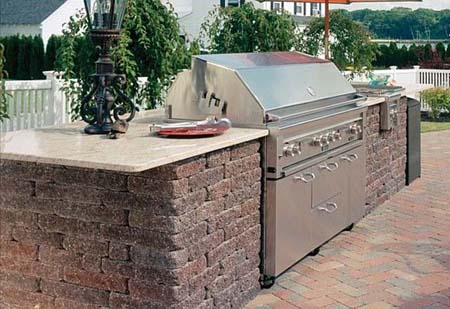 Outdoor kitchen for slide-in grill