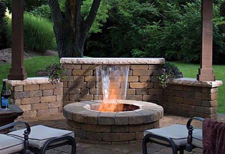 Brick patio with water feature and fire pit.