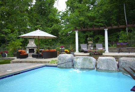 Pool patio with stone fireplace